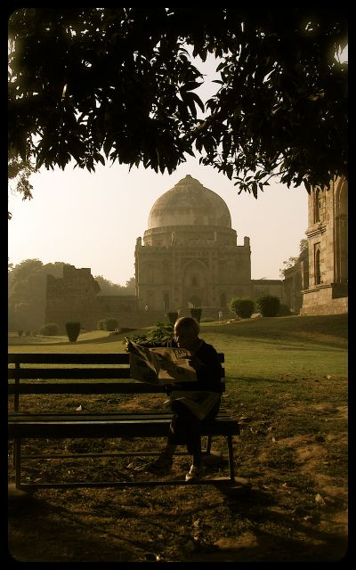 Man reading in the Lodi Gardens - New Delhi India