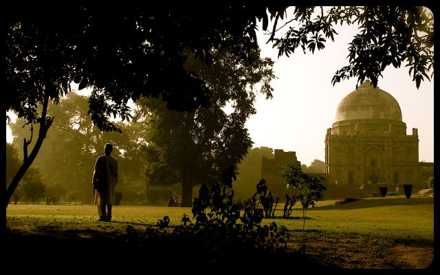 Man doing sun salutation in the Lodi Gardens - New Delhi, India