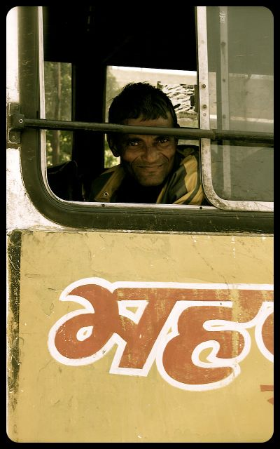 Man riding bus in Jaipur, India