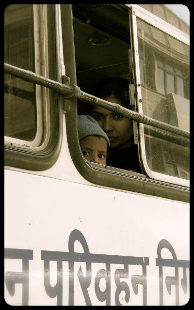 Woman riding bus in Jaipur, India