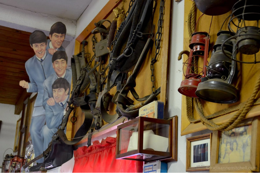 Beatles insignia, harnesses and lamps hang on the walls of the Mr. Maestas Mexican-American restaurant, Holbrook, Arizona
