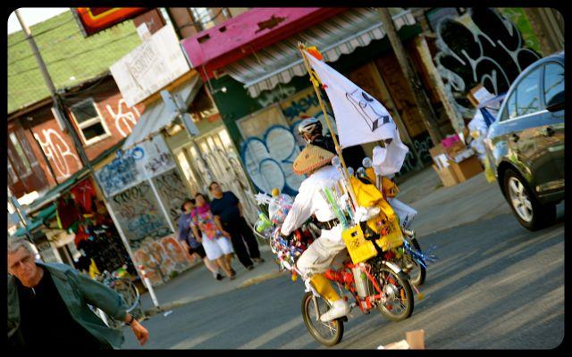 Man in costume riding in Kensington, Toronto