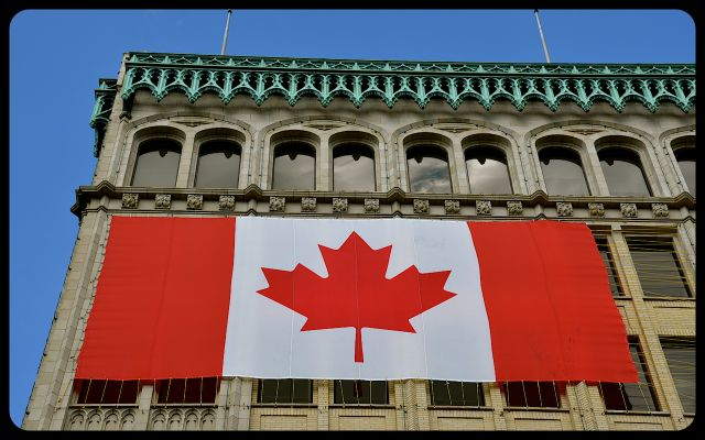 """Canadian Flags on """"Confederation Edifice Building"""""""