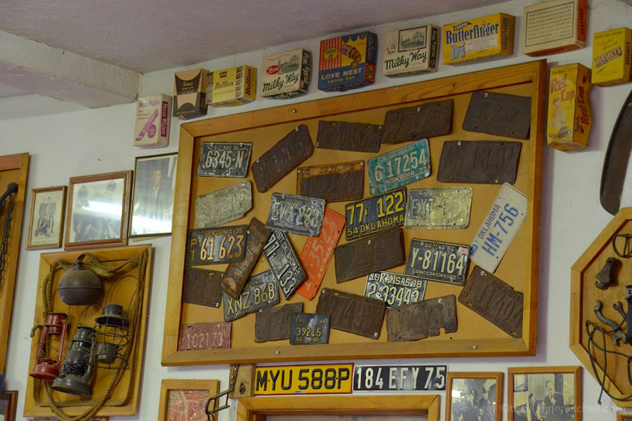 Old American license plates hang on the wall of Mr. Maestas, along with vintage candy tins. The restaurant is located on Route 66 in Arizona.