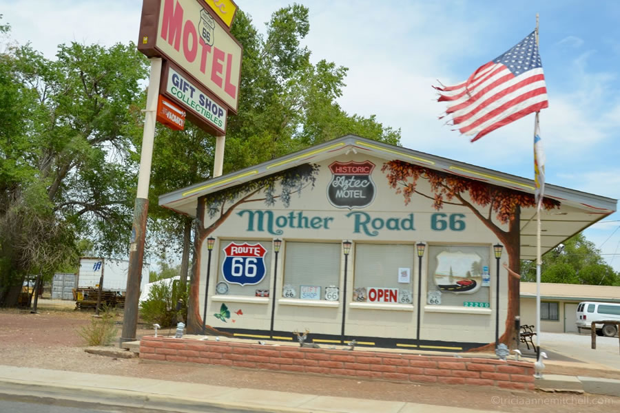 An American flag flies in front of the Aztec Motel, along Route 66 in Seligman Arizona.