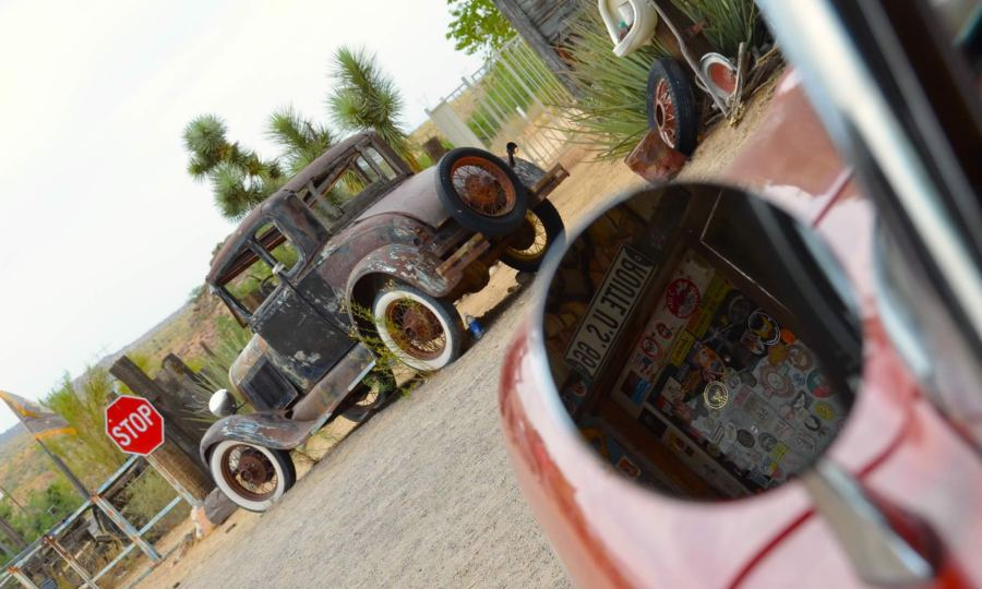 A vintage car sits parked at a vintage gas station on historic Route 66, in Arizona.