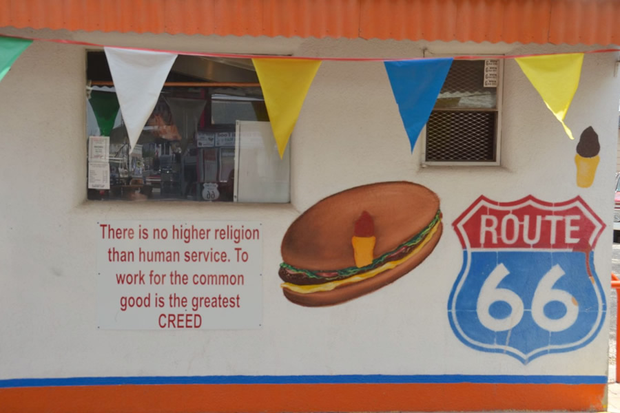 "A sign on Delgadillos Snow Cap (a Route 66 diner in Seligman) reads: ""There is no higher religion than human service. To work for the common good is the greatest creed."""