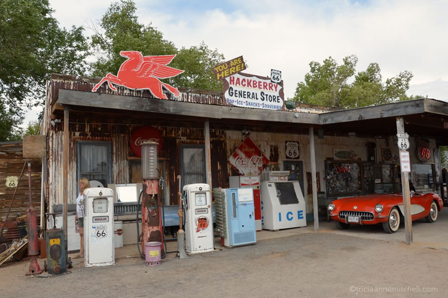 Vintage gas pumps, signs, and a Corvette convertible adorn the exterior of the Hackberry General Store, along Route 66 in Arizona.