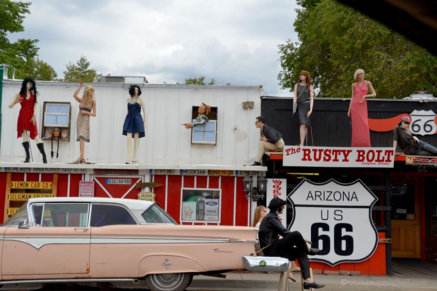 Mannequins and vintage cars sit outside the Rusty Bolt Gift Shop, along Route 66 in Seligman, Arizona.