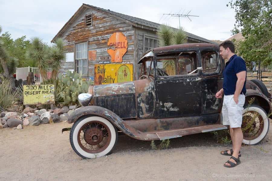 A man peers into a vintage car at the Hackberry General Store, along Arizona's stretch of route 66.