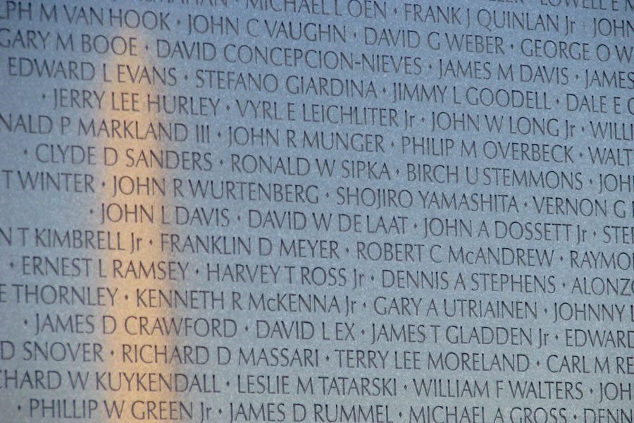 Washington Monument reflected on Vietnam Memorial wall of names