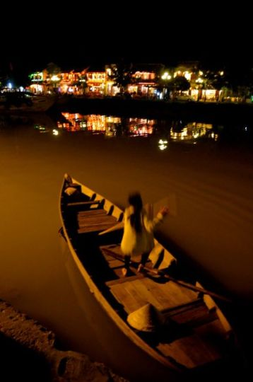 woman in boat in hoi an vietnam at night