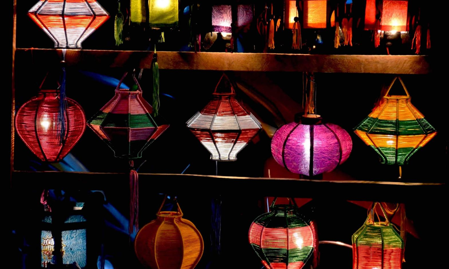 Colorful beaded lanterns hang outside a lantern shop in Hoi An, Vietnam.