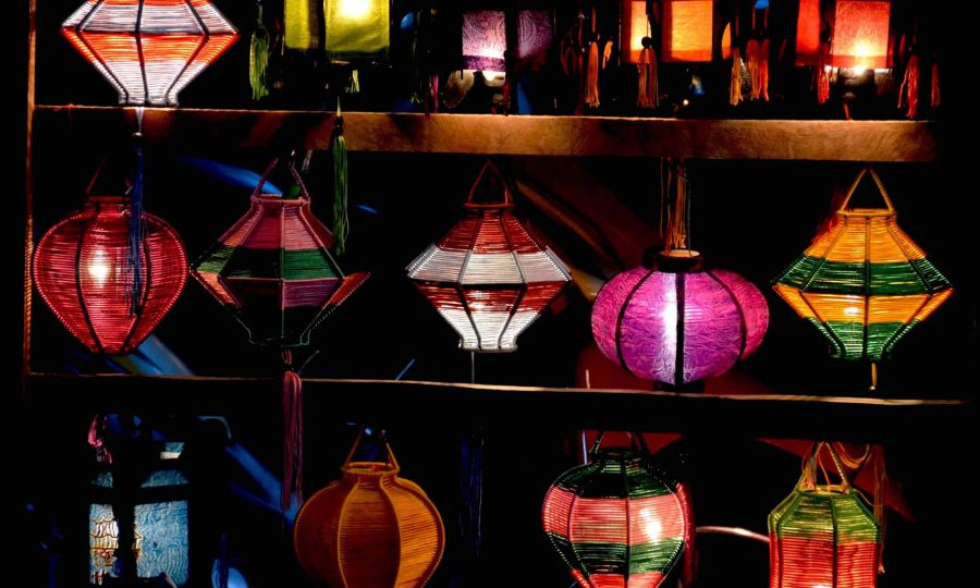 Colorful beaded lanterns hang outside a lantern shop in Hoi An, Vietnam.