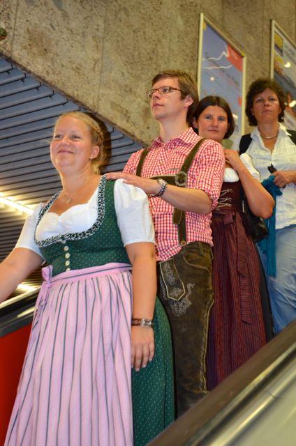People on escalator for Oktoberfest in Munich