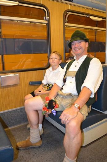 Father and son on streetcar for Oktoberfest in Munich