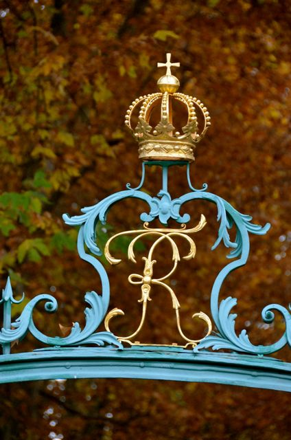 Regal blue and gold gate ornamentation at the Ludwigsburg Palace during the annual Pumpkin Fest.
