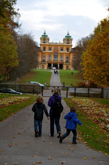 A family walks the grounds of the Ludwigsburg  Palace during its yearly Pumpkin Fest in Germany.