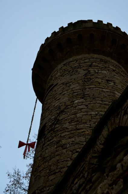A braid-like rope with a ribbon dangles from a stone tower at the Ludwigsburg Pumpkin Fest in Germany.