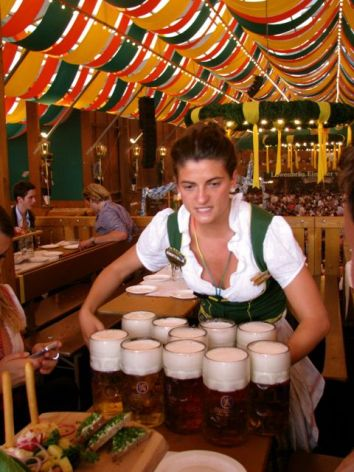 Waitress serving bier at Oktoberfest