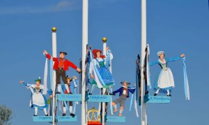 Decorations depicting men and women in traditional German costumes, at Oktoberfest celebrations in Munich, Germany.