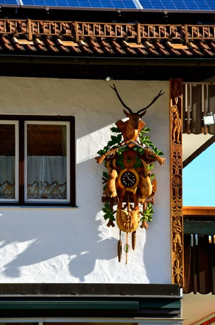 A cuckoo clock hangs outside of a shop in Oberammergau, Germany.