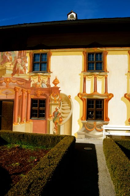 A glimpse of Oberammergau's Pilatushaus, painted with frescoed scenes.