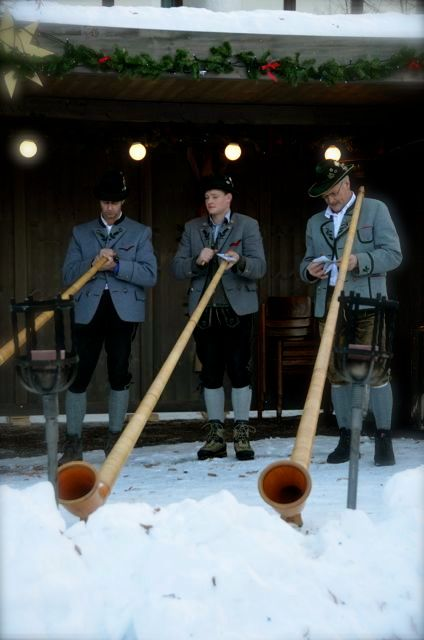 Three Alphornists perform at a winter event in the German town of Oberammergau.