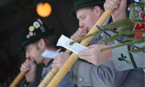 Male alphornists perform in the village of Oberammergau, Germany during a winter festival.