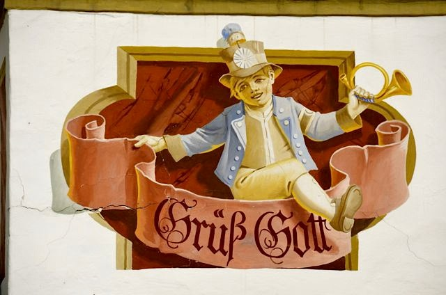 "Detail of the Hotel Alte Post in Oberammergau, Germany. The painting says ""Grüß Gott."""