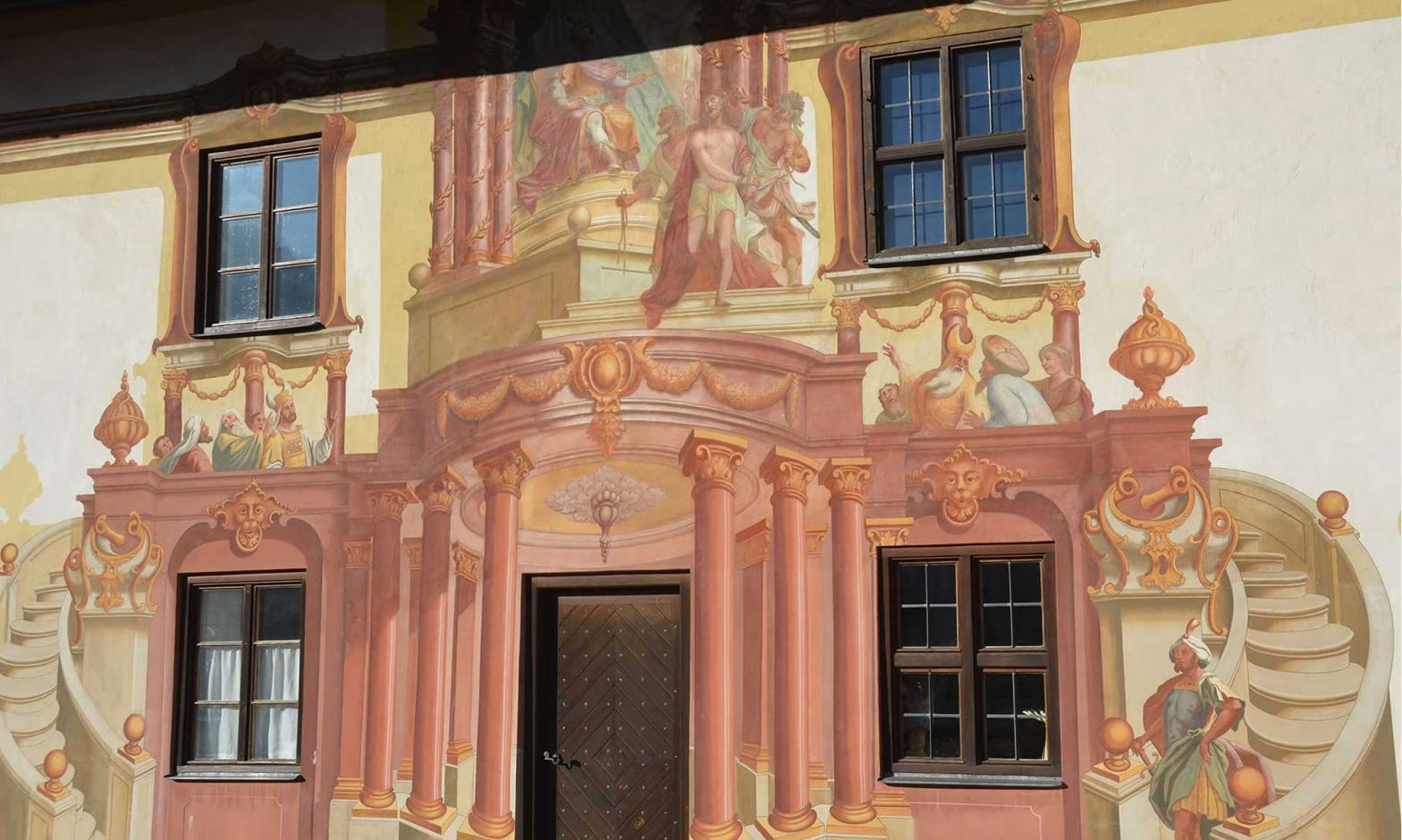 The colorful, fresco-painted facade of the Pilatushaus
