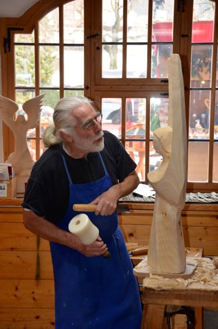 A man carves a wooden angel in Oberammergau, Germany.