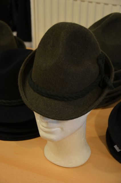 A traditional Bavarian woolen hat sits atop a mannequin head.