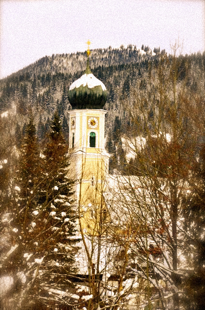 Oberammergau's main church, covered in snow.