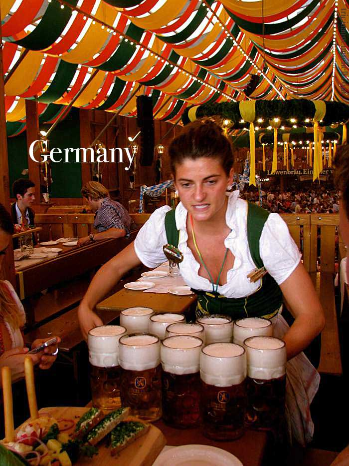 A waitress in a fest tent at Oktoberfest-carries 10 liters of beer mugs in Munich, Germany.