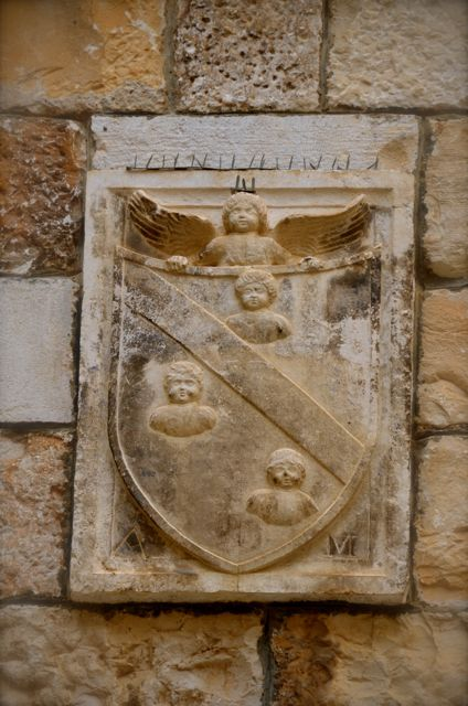 A coat of arms featuring an angel in Trogir, Croatia.