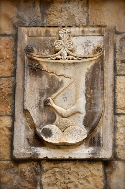 A coat of arm in the coastal Croatian city of Trogir depicts an arm holding a saber.