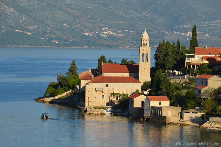 A church and its belltower, situated on Croatia's Adriatic Coast, on the island of Korcula.