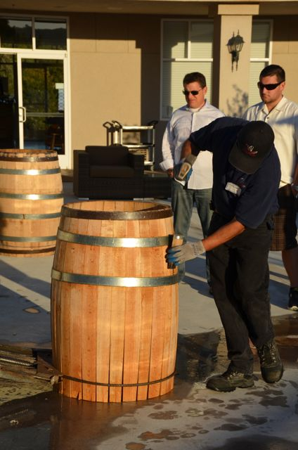 A man assembles a wooden barrel at Sbragia Winery.