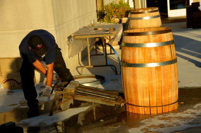 A man assembles a wine barrel in Sonoma, California.