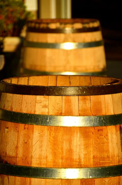 Two wooden wine barrels soak up the early-evening sunshine in California.