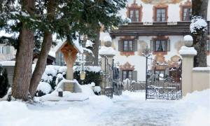 The village of Oberammergau's St. Peter and Paul Cemetery Germany, covered in snow