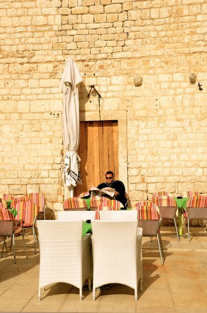 A man sits outside at the Café Padre in Trogir, Croatia.