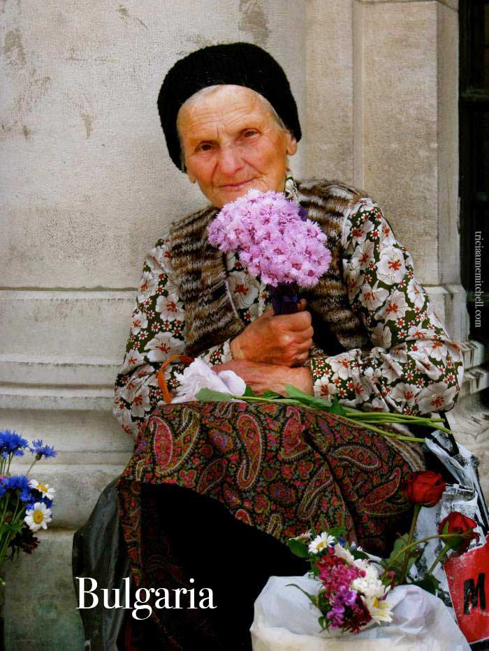 woman-with-flowers-in-sofia-bulgaria