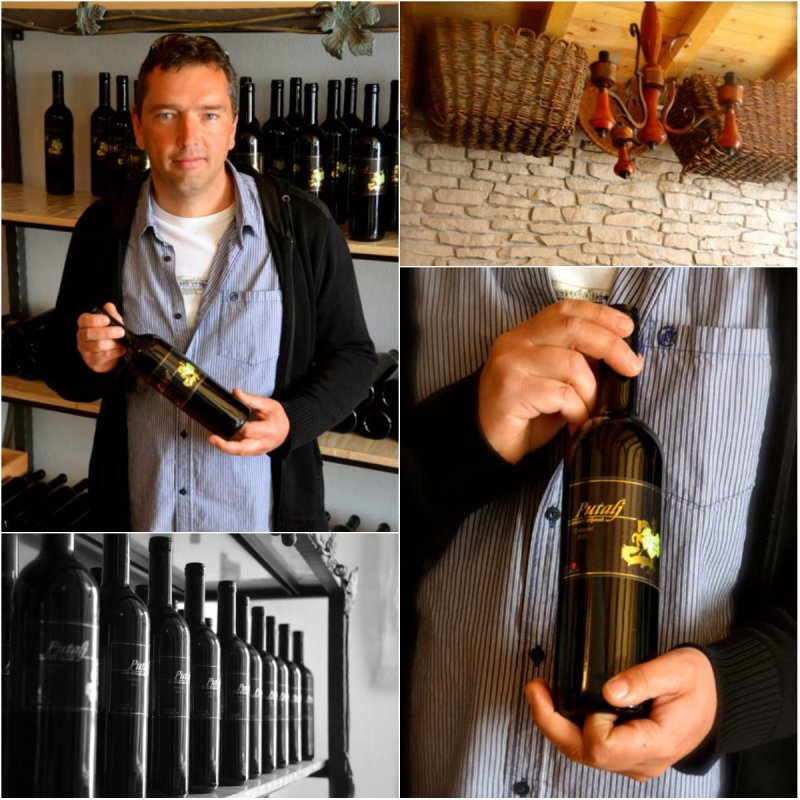 winemaker holding his bottle of wine