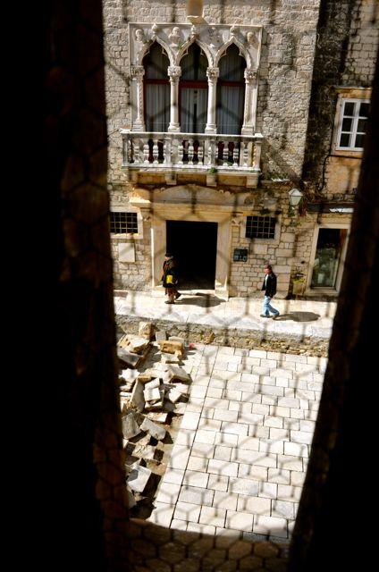 view from trogir belltower onto street