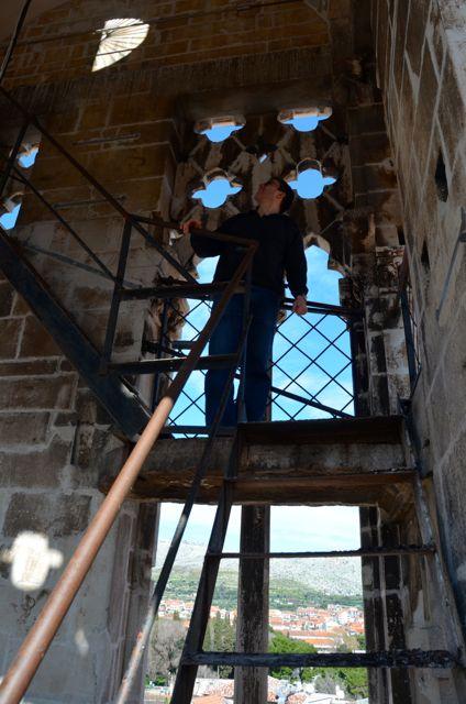 climbing in stairwell of trogir belltower