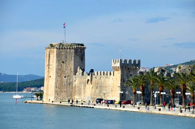 Trogir's Kamerlengo Fortress sits along the edge of the water in coastal Croatia.
