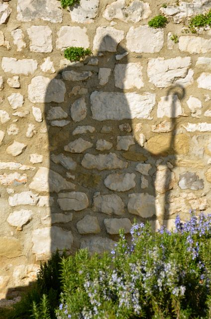 Bishop statue's shadow in Trogir Croatia