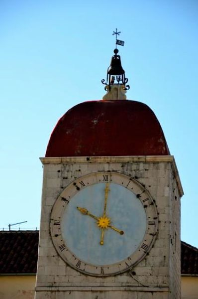 Clock tower detail in Trogir (bell and clockface)
